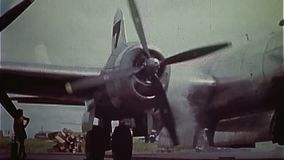 WWII US Air Force – B29 aircraft starts engine. World War II Color. A B-29 aircraft is starting its engine stock video