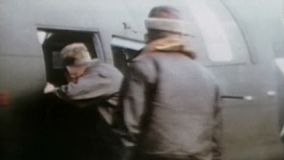 WWII US Air Force – Pilots enter aircraft. World War II Color. Pilots enter their aircraft for a start stock video footage
