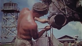 WWII US Air Force – Soldiers work at engines of B29 aircraft. World War II Color. Soldiers change the engines of a B-29 aircraft. The soldiers check the stock video