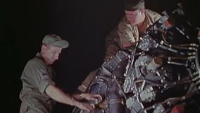 WWII US Air Force – Soldiers work at engines of B29 aircraft. World War II Color. Soldiers check the changed engines of a B-29 aircraft stock footage
