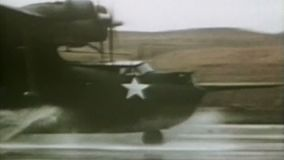 WWII US Air Force – Aircrafts land on a wet airfield stock video footage