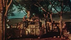 WWII – US Tanks and trucks drive along a road in Afrika – Convoy rust stock video