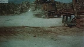 WWII – US Tanks and trucks drive along a road in Afrika stock footage