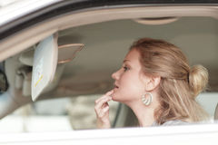 WWoman applying makeup in her car Stock Photo