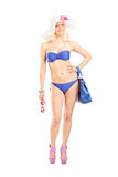 Wwoman in bikini holding a pair of sunglasses Royalty Free Stock Images