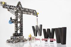 WWW com guindaste e trabalhador. fotografia de stock