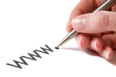 WWW Handwriting. Hand with pen writing an url, starting with www Royalty Free Stock Image