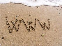 WWW op zand Stock Afbeelding