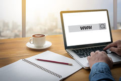WWW Website Online Internet Web Page computer. Computing Computer flare sun, Cropped image male freelancer sitting at the table royalty free stock photography