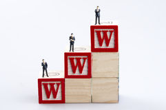 WWW word and business man toy Royalty Free Stock Photo