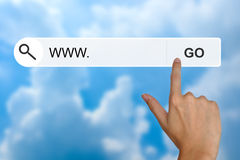 Www or world wide web on search toolbar. Hand click www or world wide web button on search toolbar royalty free stock photography