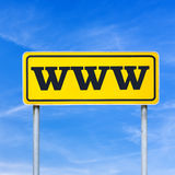 Www written on street sign. Www written on yellow street sign. Over blue sky Stock Photography