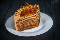 Wyśmienicie tort na drewnianym czarnym tle Zdjęcie Stock