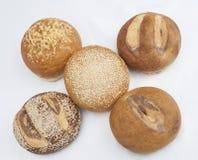Wybór chlebowi bochenki na bielu Obrazy Royalty Free