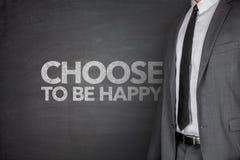 Wybiera być szczęśliwy na blackboard Obrazy Royalty Free