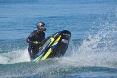Freestyle Jet Skier performing. Royalty Free Stock Image