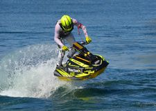 Freestyle Jet Skier performing 360  creating at lot of spray. Royalty Free Stock Photos