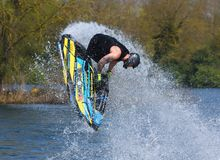 Freestyle Jet Skier performing 360  creating at lot of spray Stock Images