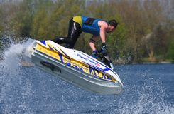 Freestyle Jet Skier performing 360 creating at lot of spray. WYBOSTON, BEDFORDSHIRE, ENGLAND - APRIL 21, 2018: Freestyle Jet Skier performing 360 creating at lot Royalty Free Stock Image