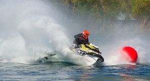 Jet Ski competitor cornering at speed creating at lot of spray. WYBOSTON, BEDFORDSHIRE, ENGLAND -  APRIL 09, 2017: Jet Ski competitor cornering at speed Stock Photos