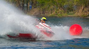 Jet Ski competitor cornering at speed creating at lot of spray. WYBOSTON, BEDFORDSHIRE, ENGLAND -  APRIL 09, 2017: Jet Ski competitor cornering at speed Royalty Free Stock Photography