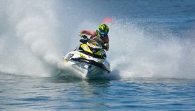 Jet Ski cornering at speed creating at lot of spray. WYBOSTON, BEDFORDSHIRE, ENGLAND -  APRIL 09, 2017: Jet Ski cornering at speed creating at lot of spray Stock Image