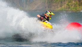 Jet Ski cornering at speed creating at lot of spray. WYBOSTON, BEDFORDSHIRE, ENGLAND -  APRIL 09, 2017: Jet Ski cornering at speed creating at lot of spray Royalty Free Stock Photo