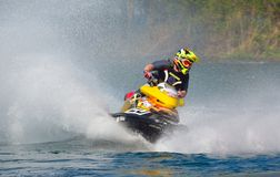 Jet Ski cornering at speed creating at lot of spray. WYBOSTON, BEDFORDSHIRE, ENGLAND -  APRIL 09, 2017: Jet Ski cornering at speed creating at lot of spray Royalty Free Stock Photos