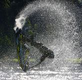 Freestyle Jet Skier performing Back Flip  creating at lot of spray. Royalty Free Stock Photo
