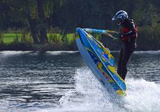 Freestyle Jet Skier performing Jump  creating at lot of spray. Royalty Free Stock Image
