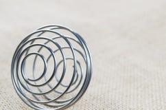 Wybrana ostrość - Przerzedże kawałek spirala na podłoga obrazy stock