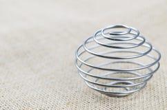 Wybrana ostrość - Przerzedże kawałek spirala na podłoga obraz stock