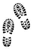 Wycieczkować buty, odciski stopy Obraz Royalty Free