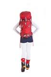 Wycieczkowicz kobieta z plecakiem odizolowywającym na białym tle, iść a Zdjęcia Stock