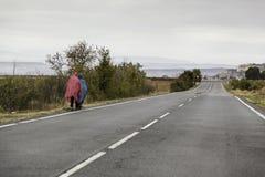 Wycieczkowicze z podeszczowym Santiago Obraz Stock