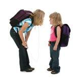 wycinek dziewczyn do szkoły z drogi Obrazy Royalty Free