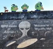 UFO painting on the wall at the petrol station. Wycliffe Well, Australia - Jun 12, 2018. UFO painting on the wall at the petrol station. Wycliffe Well is the stock photo
