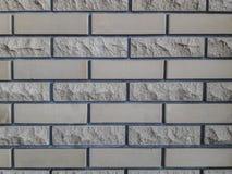 Wykończeniowe cegły dla ścian Gładki i odłupany Szary tło powierzchowność obrazy royalty free