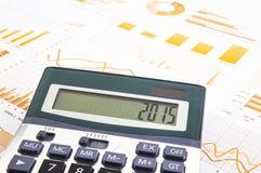 Wykresu tło z 2015 liczbami na kalkulatorze Obrazy Stock