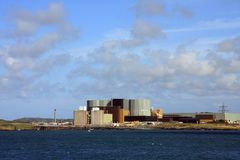 Wylfa Nuclear Power station. From Cemlyn Bay a National Trust Wildlife Pool on the Isle of Anglesey Stock Images