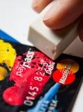 Wymazuje kredytowej karty dług obrazy stock