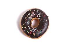 Wyśmienicie kusicielski czekoladowy pączek z polewy niezdrowego odżywiania nałogu cukrowym słodkim pojęciem Zdjęcia Royalty Free