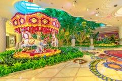 Wynn Las Vegas carousel. Las Vegas, Nevada, USA - August 18, 2018: animated flowers carousel and beautiful decorations garden indoor luxurious and elegant Wynn stock photography