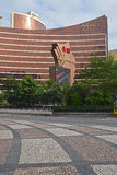 Wynn Macau seen from across the main road with Portuguese Calcada Pavement Stock Image
