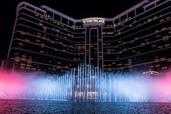 Wynn palace macau, nightitme fountain, water feature with large water jets. Impressive wynn palace resort hotel with the impressive musical fountain, white Royalty Free Stock Photography