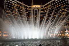 Wynn palace macau, nightitme fountain, water feature with large water jets. Impressive wynn palace resort hotel with the impressive musical fountain, white Royalty Free Stock Photo