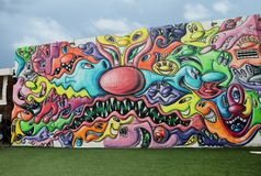Wynwood Walls Miami. Wynwood Walls is an outdoor art museum displaying a large scale colorful murals in midtown Miami, Florida Stock Image