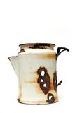 Wyoming coffee pot. An old, white, metal coffee pot - apparently used by someone as target practice at some point. it was found laying in the middle of nowhere Royalty Free Stock Photos
