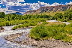 Wyoming High Plains Stream. High plains stream in Wyoming with blue sky and white clouds in the background stock images