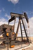 Wyoming Industrial Oil Pump Jack Fracking Crude Extraction Machi Royalty Free Stock Photos